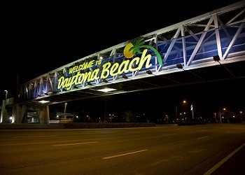 Welcome to Daytona Beach written in a foot bridge of a road, represent service area of The Realty Medics